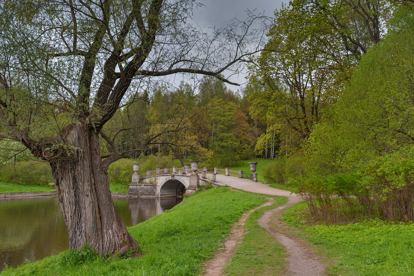 Road along Slavianka River in Pavlovsk Park. Pavlovsk, suburb of St.Petersburg, Russia
