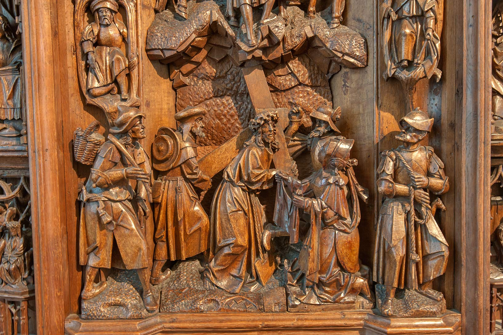 Decorated wooden panel with figures of men in Hermitage Museum. St.Petersburg, Russia