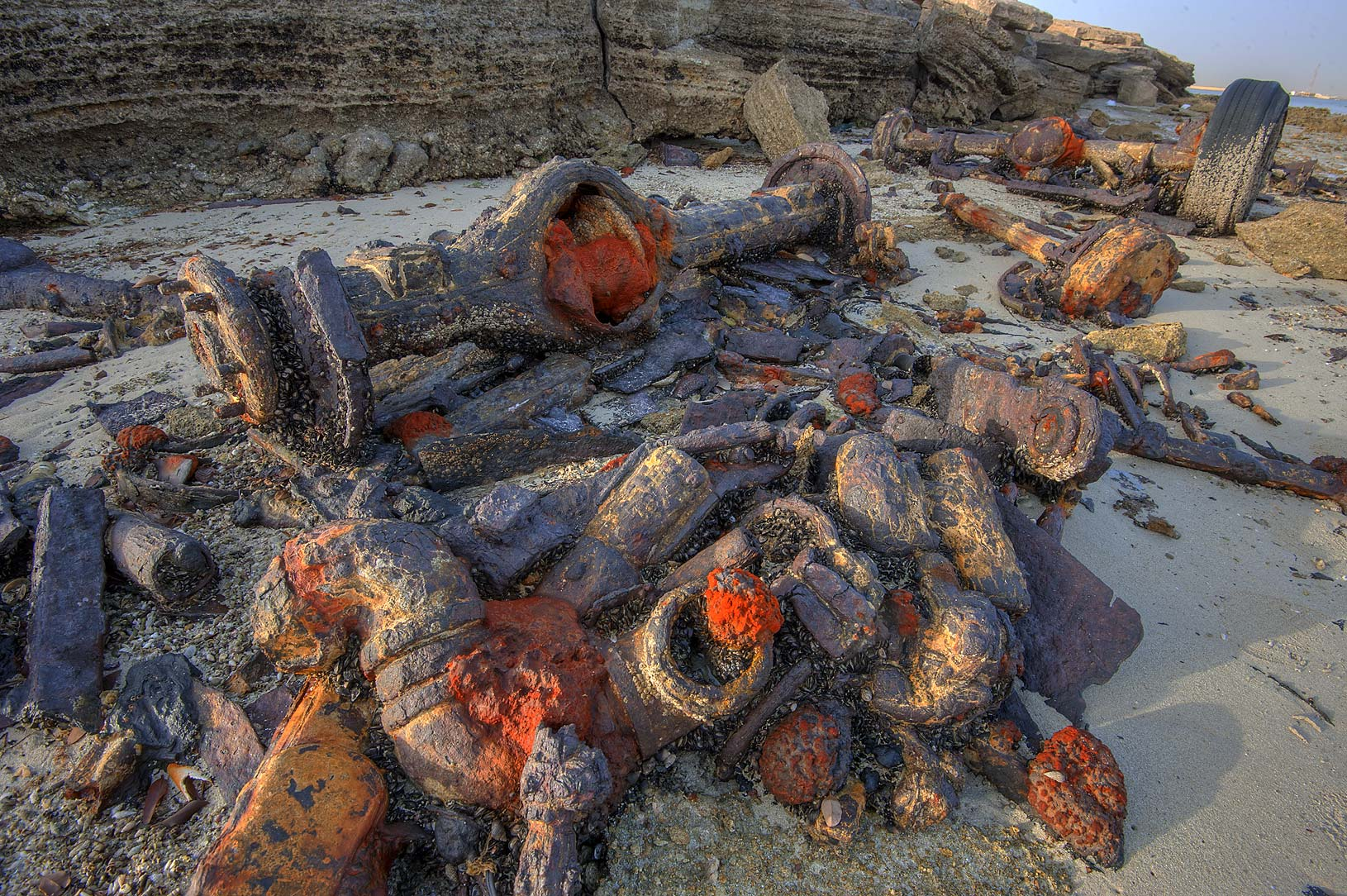 Rusty iron parts of a decomposing vehicle at low...Jazirat Bin Ghanim). Al Khor, Qatar