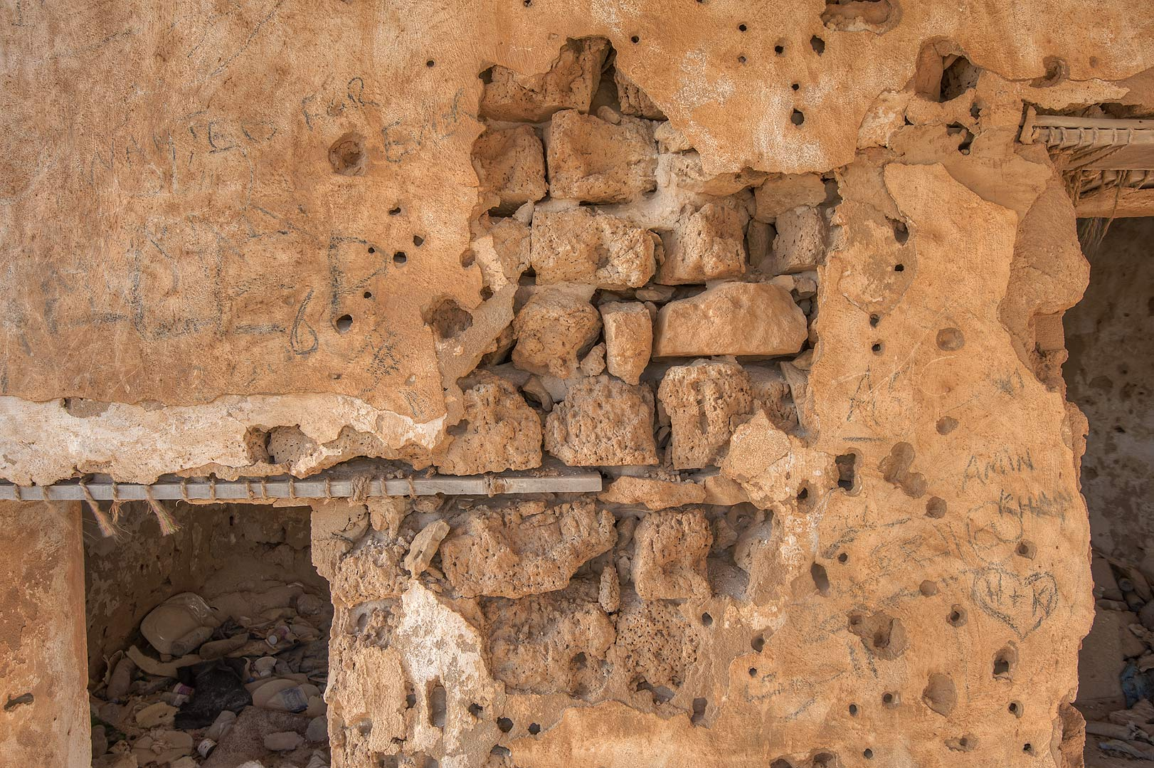 Structure of a stone wall in old fishing village...eastern coast, Ash Shamal area. Qatar