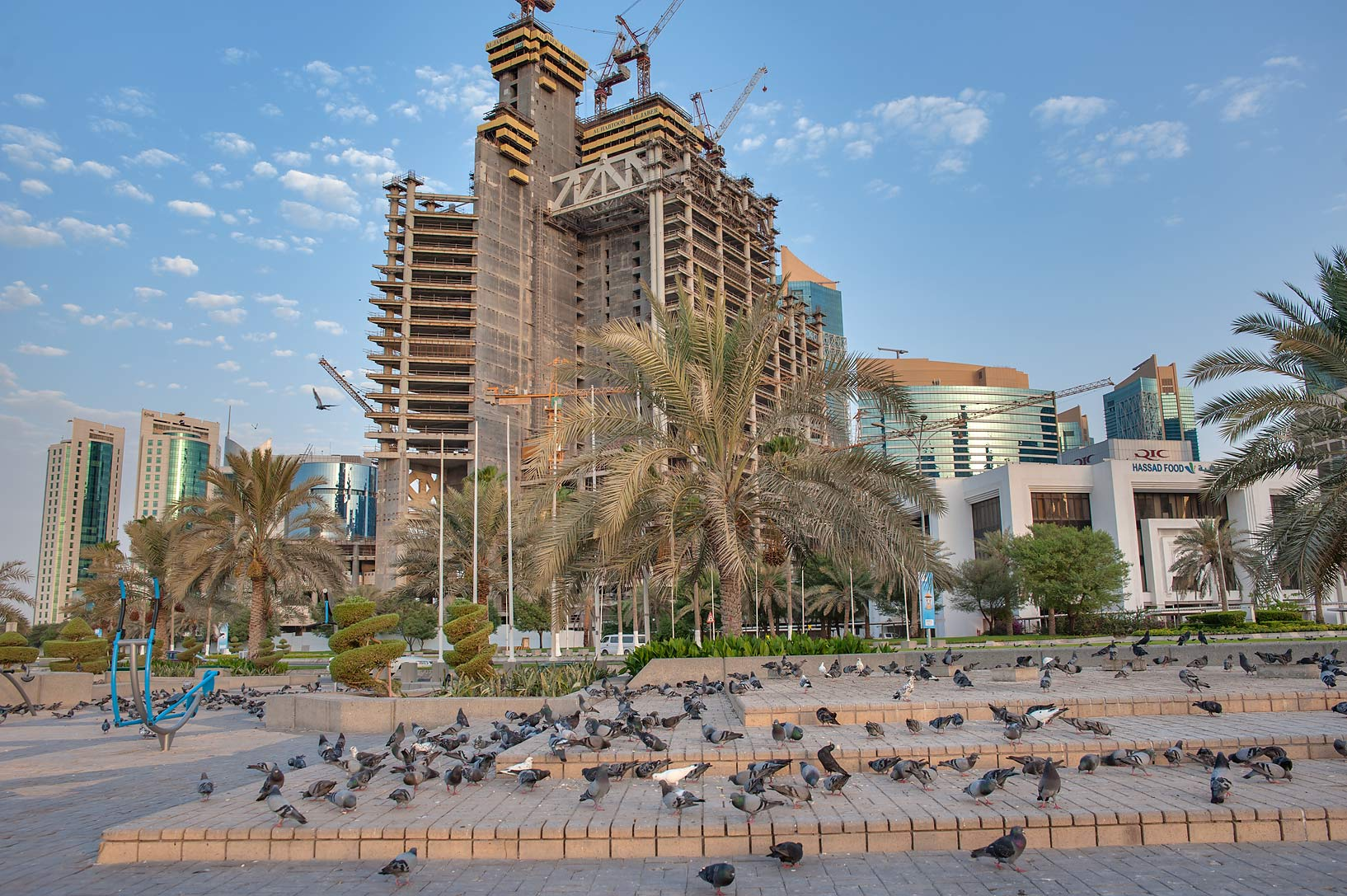 Dubai Towers in West Bay at morning, view from Corniche promenade. Doha, Qatar