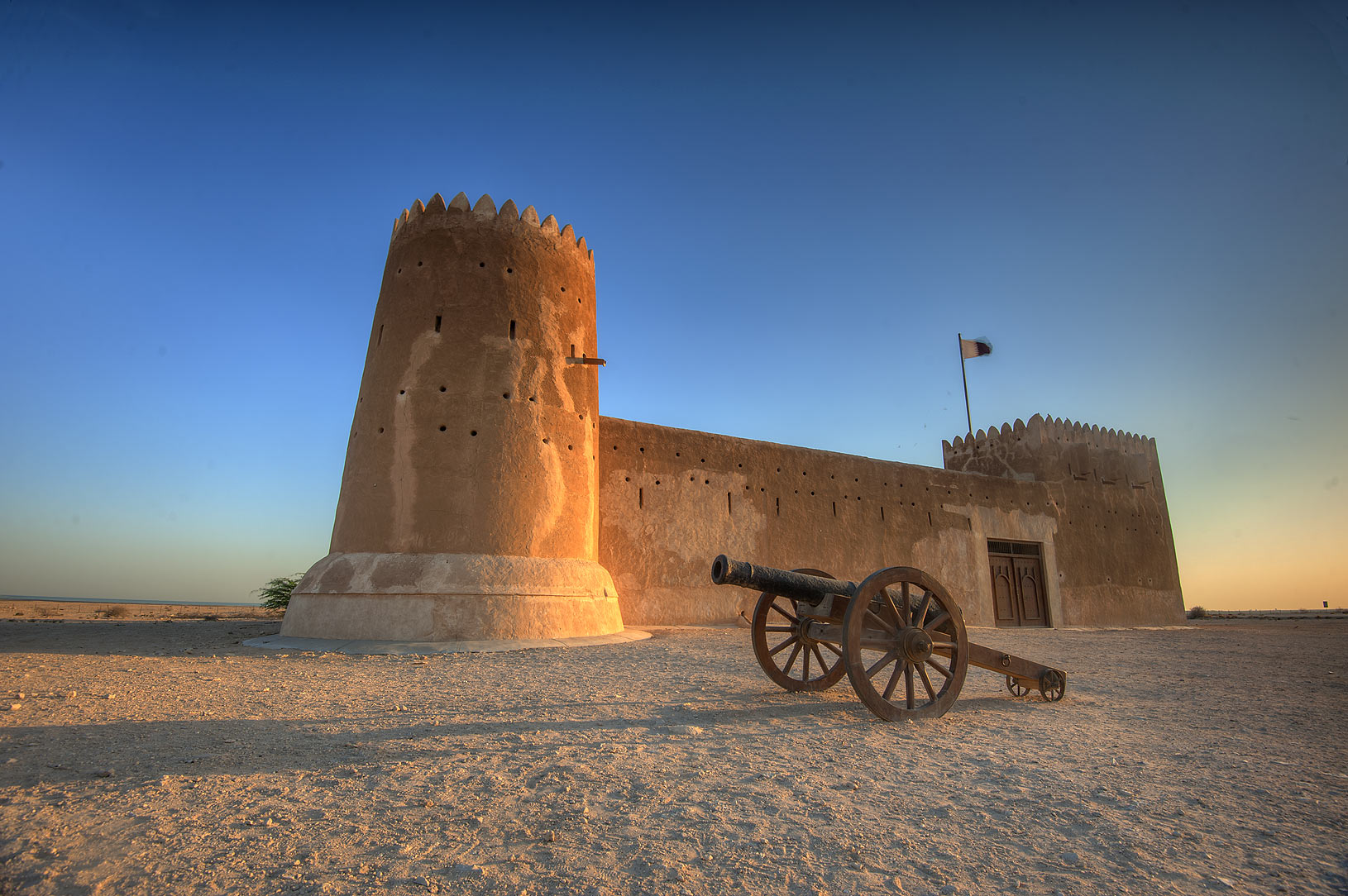 Zubara Fort and a cannon at sunrise. North-west coast, Qatar