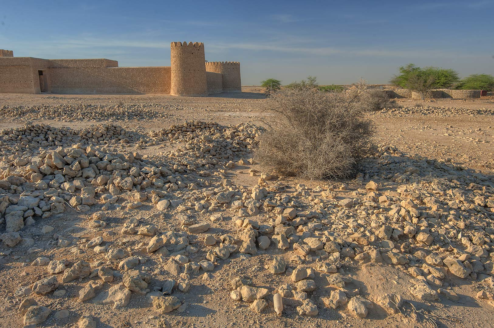 Remains of stone walls near Al Thugab Fort. North-west coast, Qatar