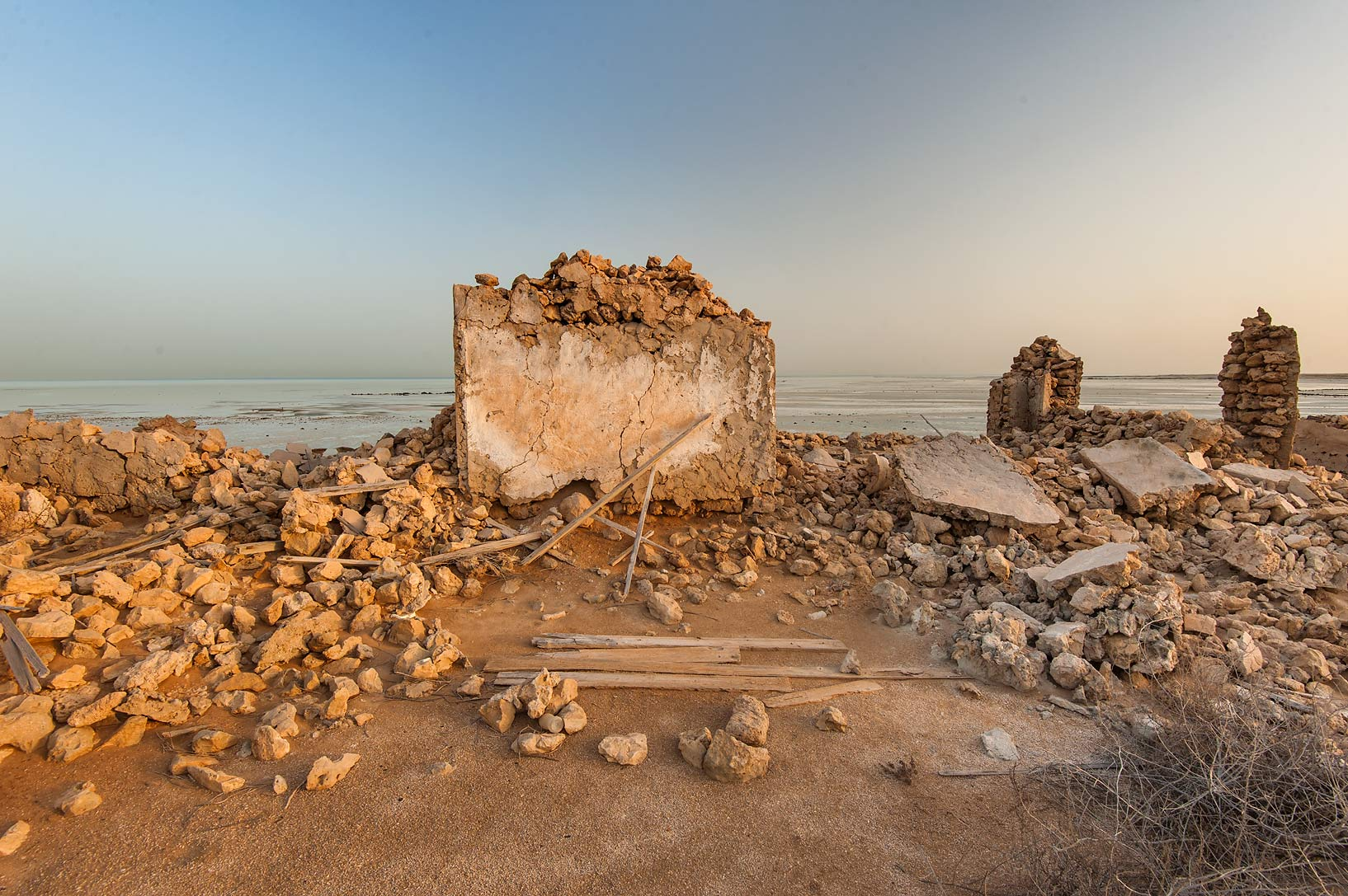 Stone wall at sunrise in a village of Al Jumail (Jumayl) west of Ruwais. Northern Qatar