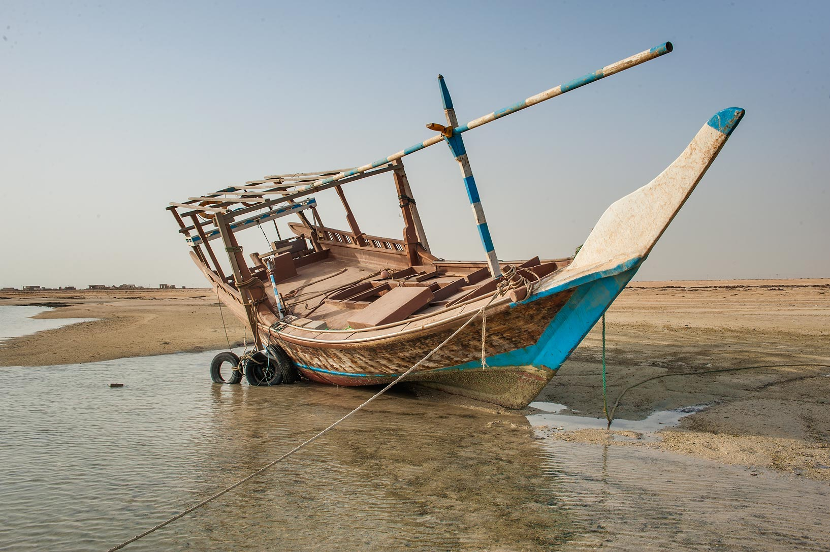 Beached dhow fishing boat in Al Mafyar (Mafjar) area on northern coast (Al Shamal). Qatar
