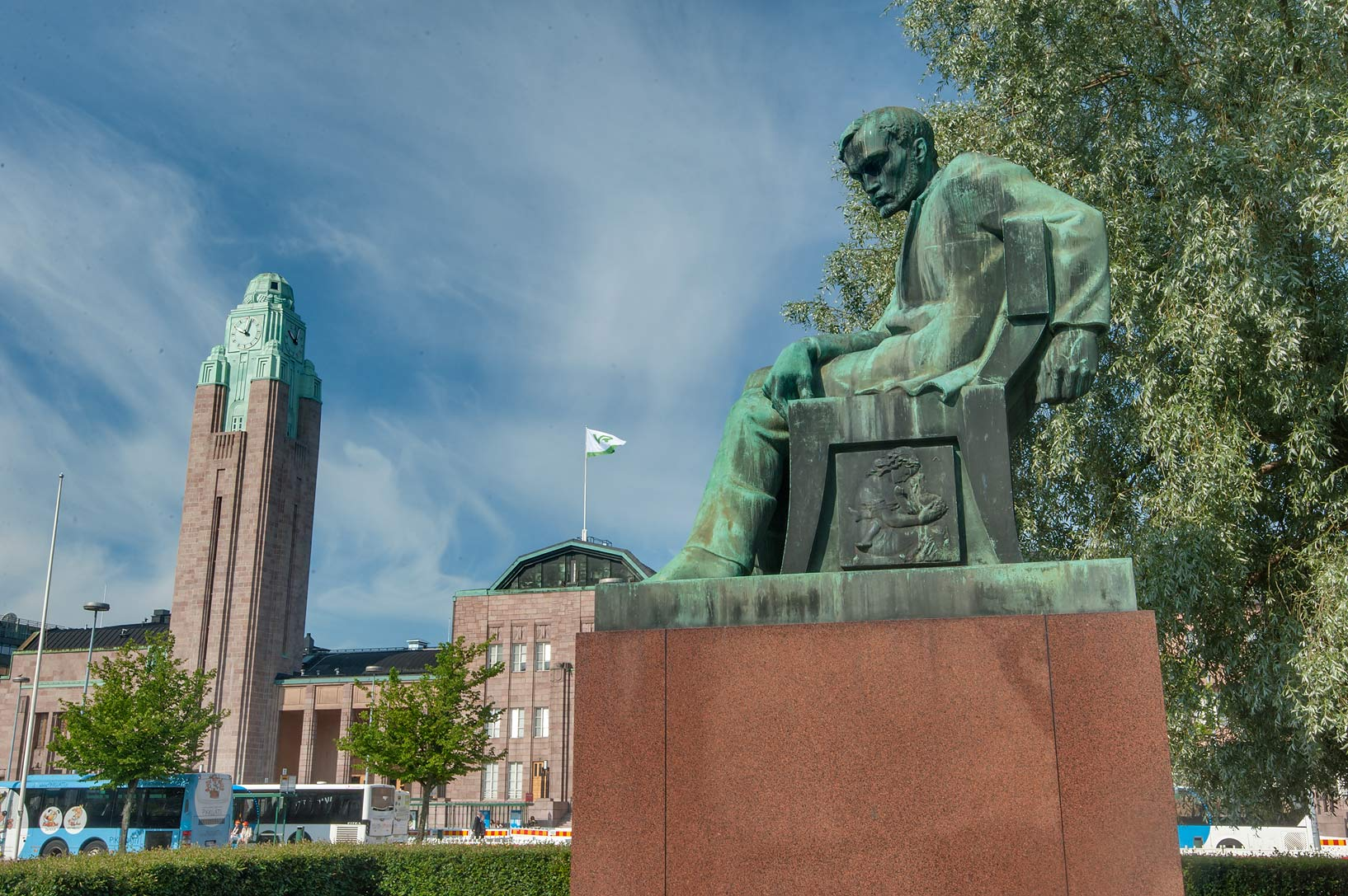 Statue of Aleksis Kivi and Central Railway Station from Railway Square. Helsinki, Finland