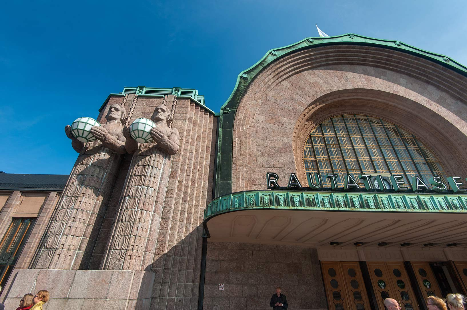 Left side of the main entrance of Central Railway Station. Helsinki, Finland