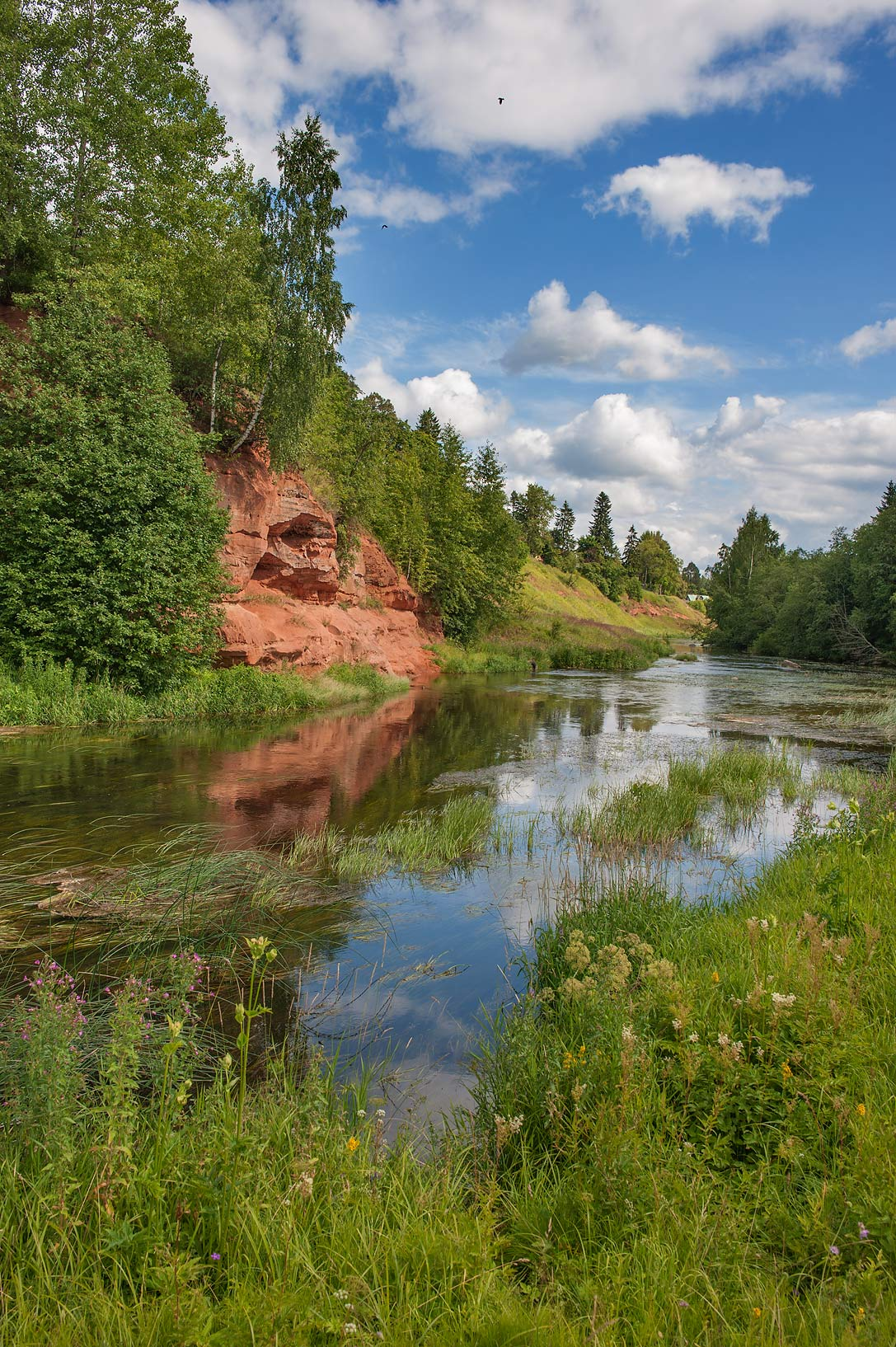 View of red sandstone cliffs of Oredezh River. Siverskaya south from St.Petersburg, Russia