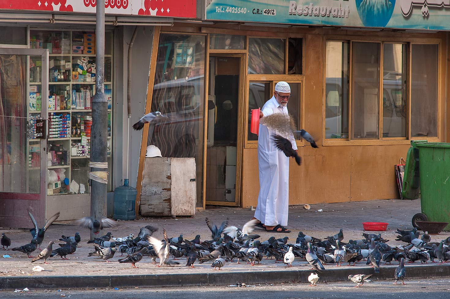 Feeding pigeons on Al Asmakh St. in Musheirib (Msheireb) area. Doha, Qatar