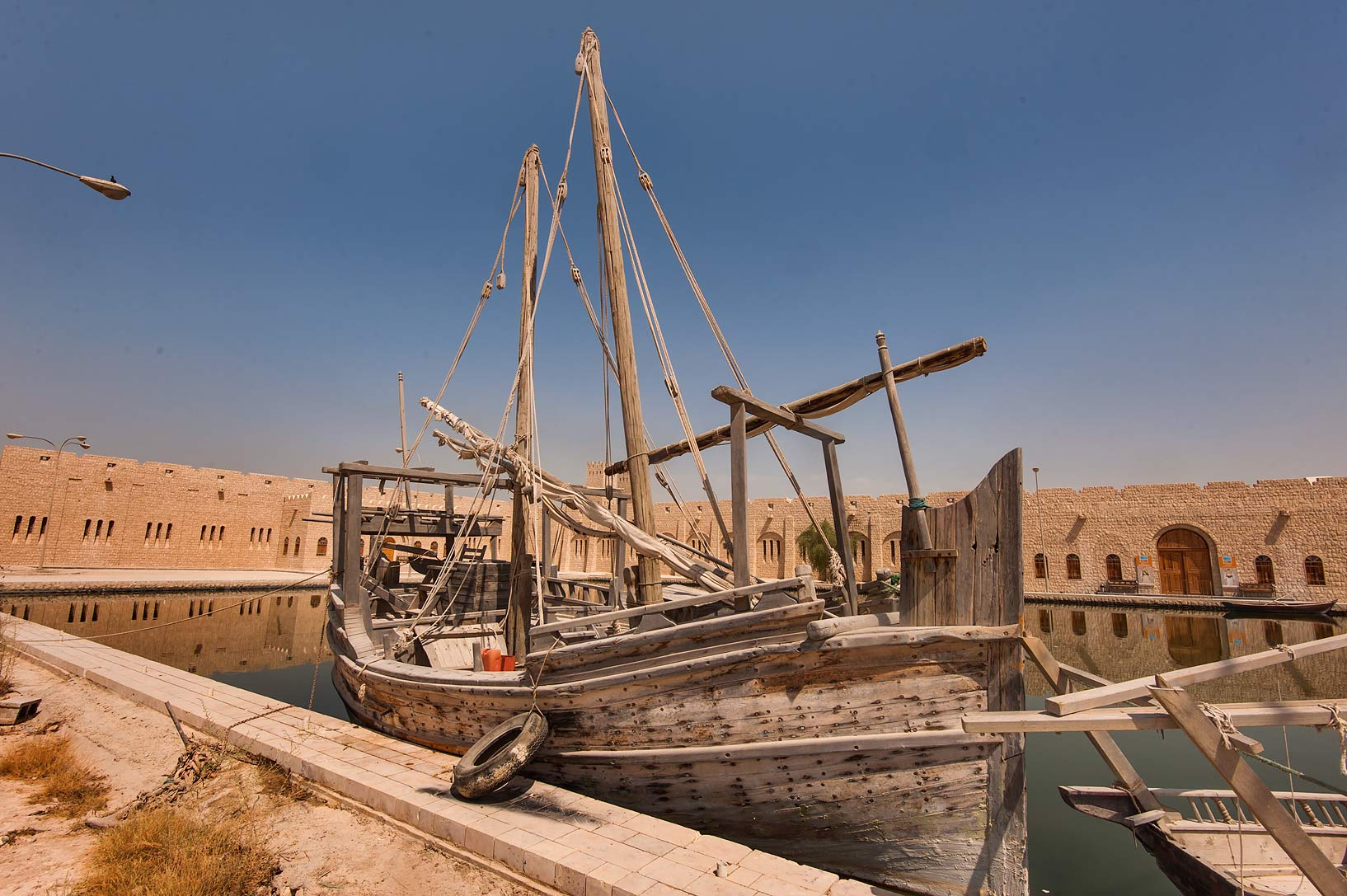 Traditional fishing boat in a pool near Sheikh...Museum near Al-Shahaniya. Doha, Qatar