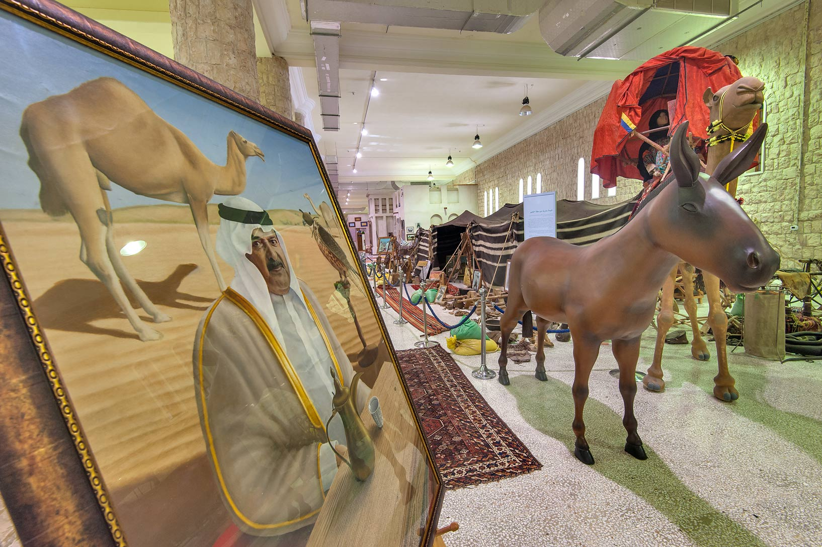 Portrait of a sheikh with a camel at the entrance...Museum near Al-Shahaniya. Doha, Qatar