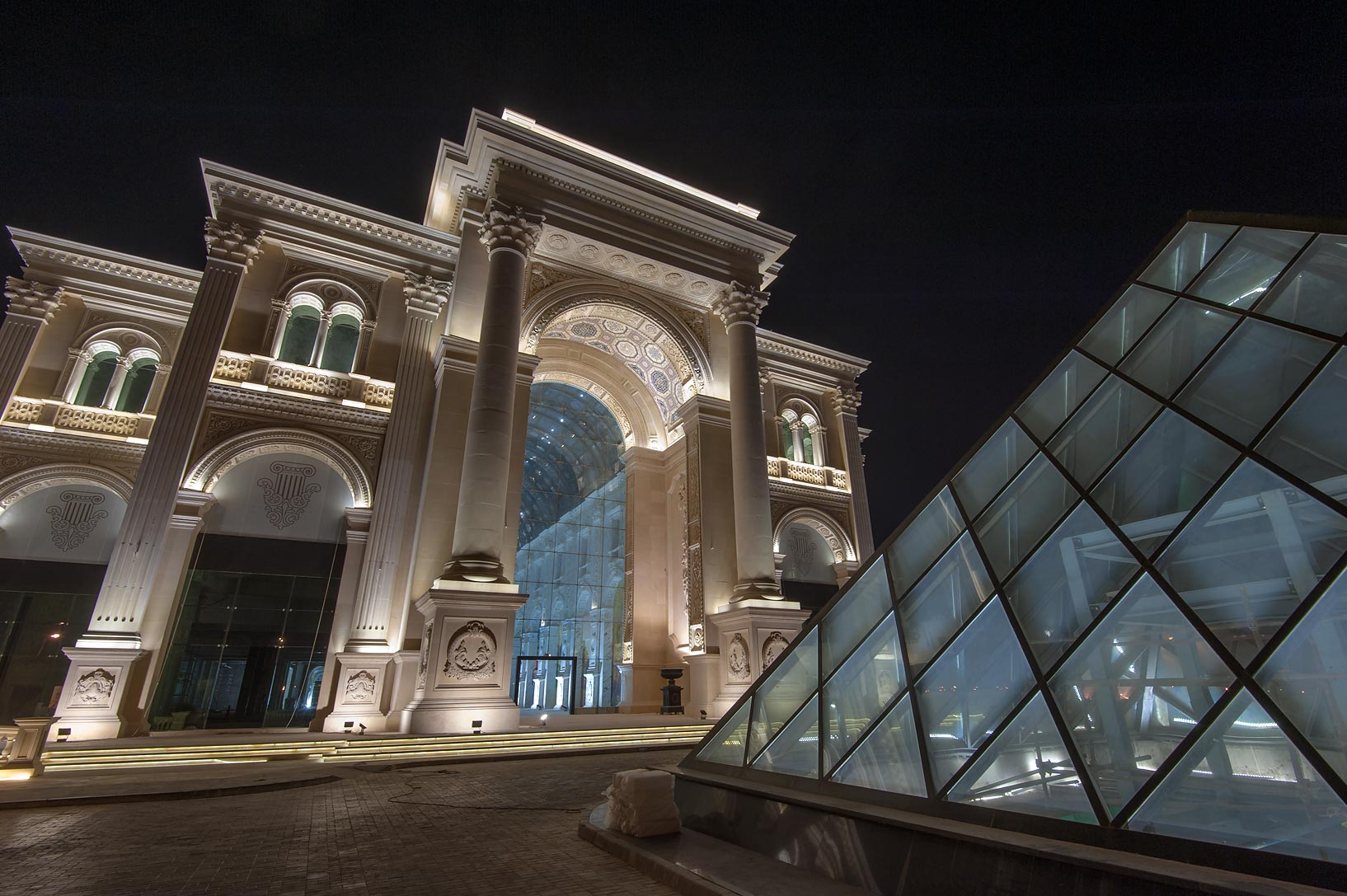 Illuminated entrance of Al Hazm Mall on Al Markhiya St.. Doha, Qatar