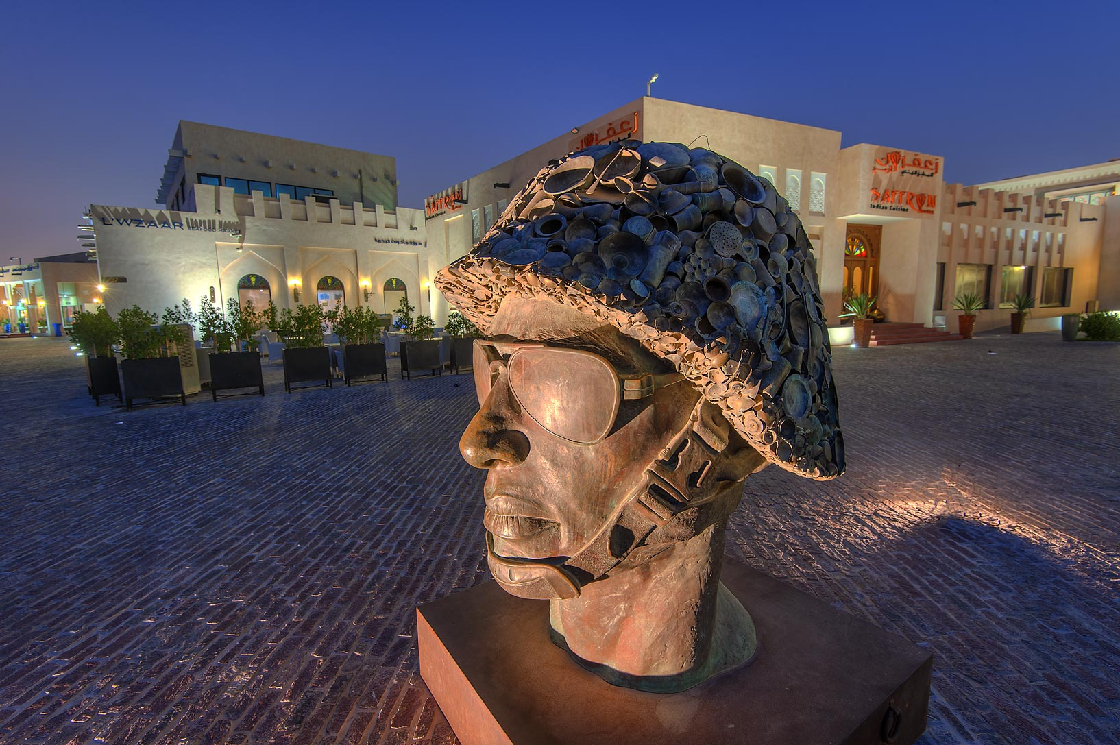 Mahatma Gandhi portrayed in military headgear by...Katara Cultural Village. Doha, Qatar