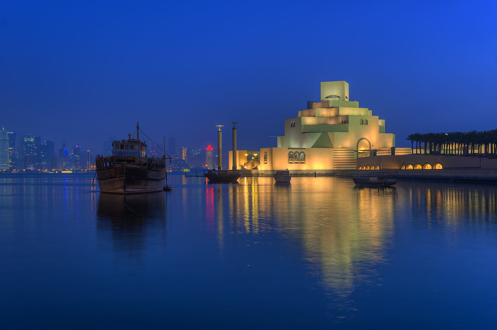 Museum of Islamic Art with a boat, view from Corniche. Doha, Qatar