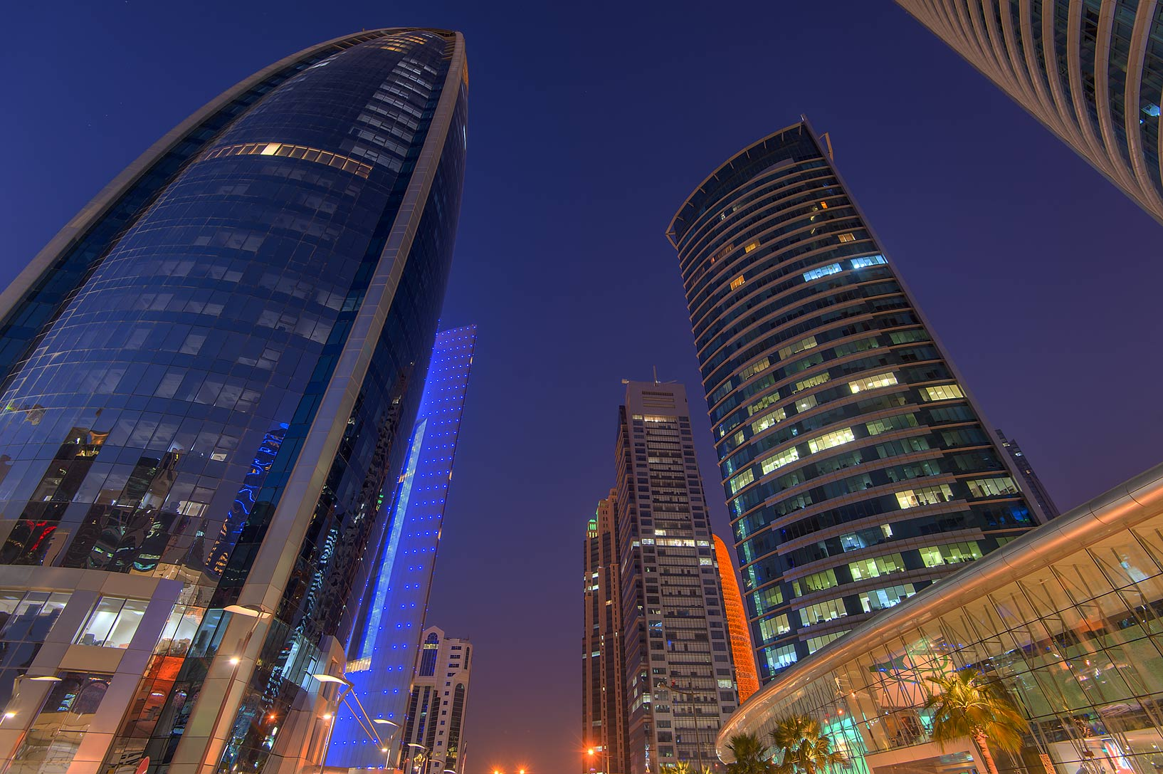 Woqod Tower from the foot of Al Fardan Twin towers in West Bay. Doha, Qatar