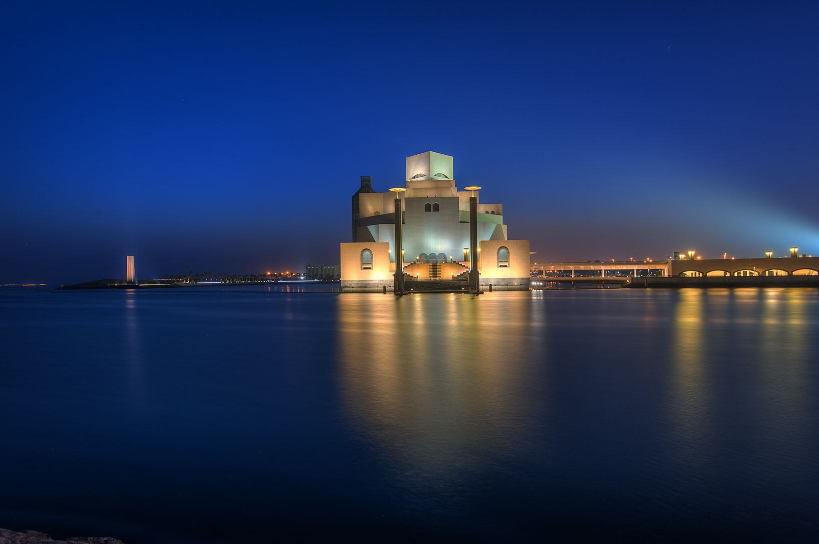 Museum of Islamic Art at dusk from a boat pier. Doha, Qatar