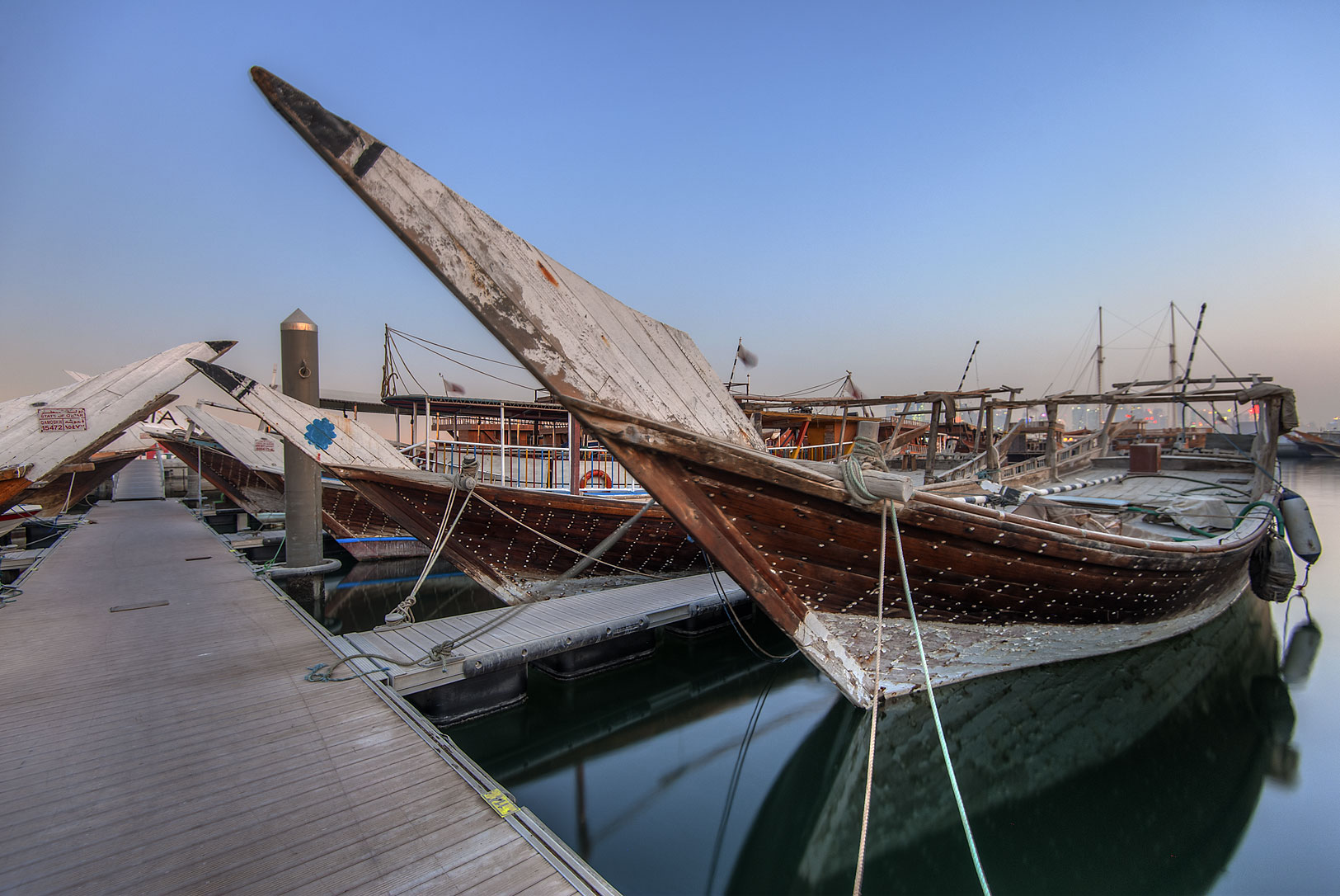 Dhow boats on a pier near Corniche at morning. Doha, Qatar