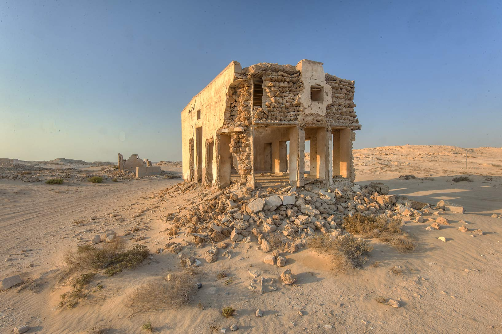 Stone ruins near a beach road in old fishing...eastern coast, Ash Shamal area. Qatar