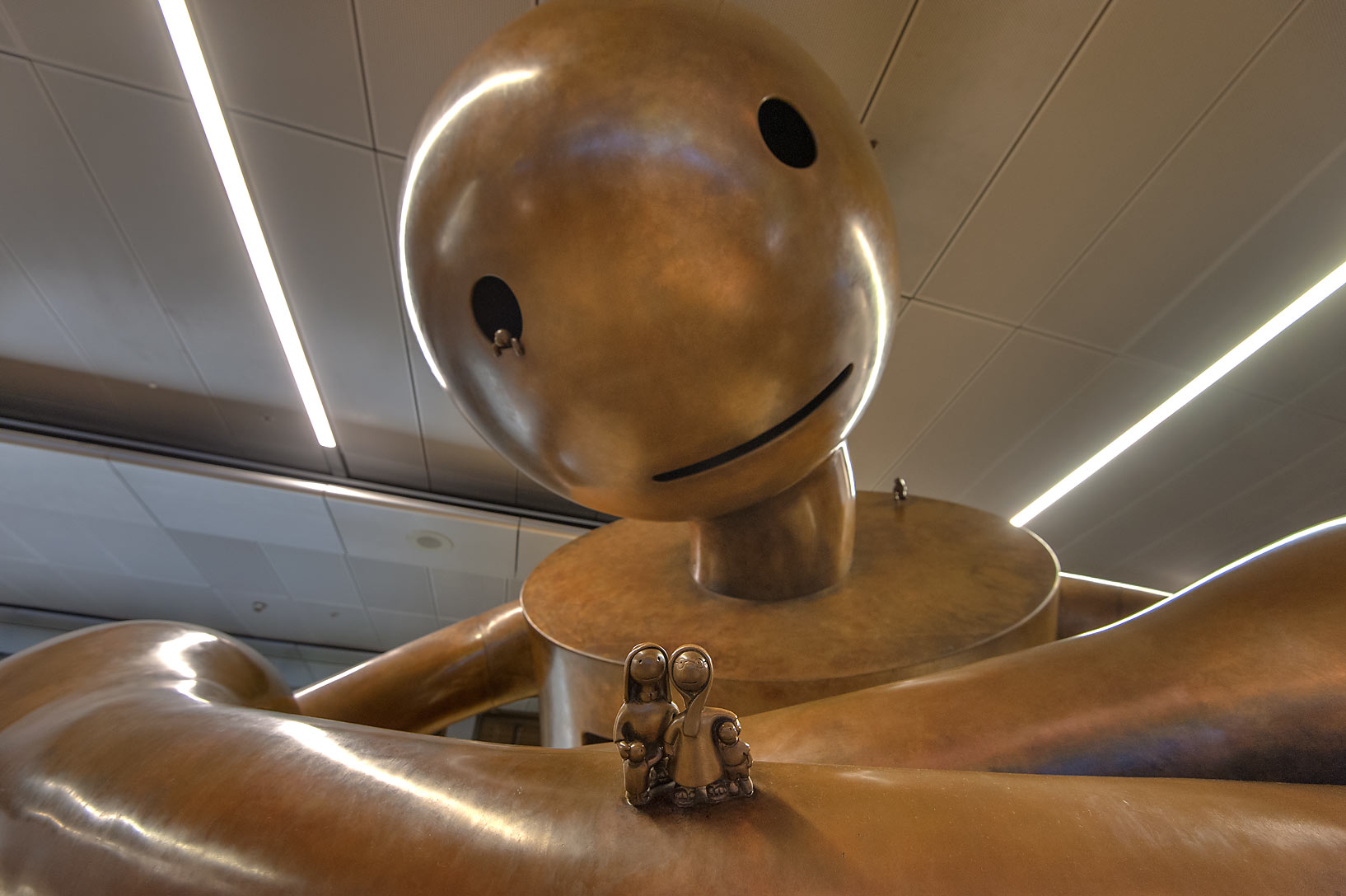Sitting figure of Playground sculpture by Tom...International Airport. Doha, Qatar