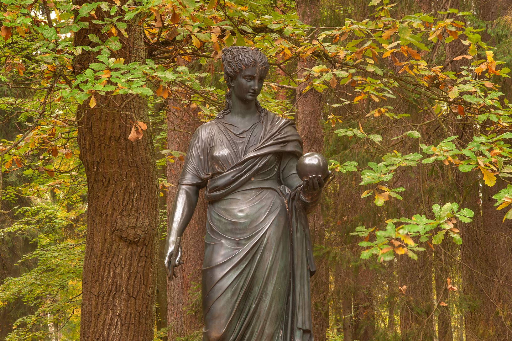 Sculpture of a Greek muse holding a bronze ball...suburb of St.Petersburg, Russia