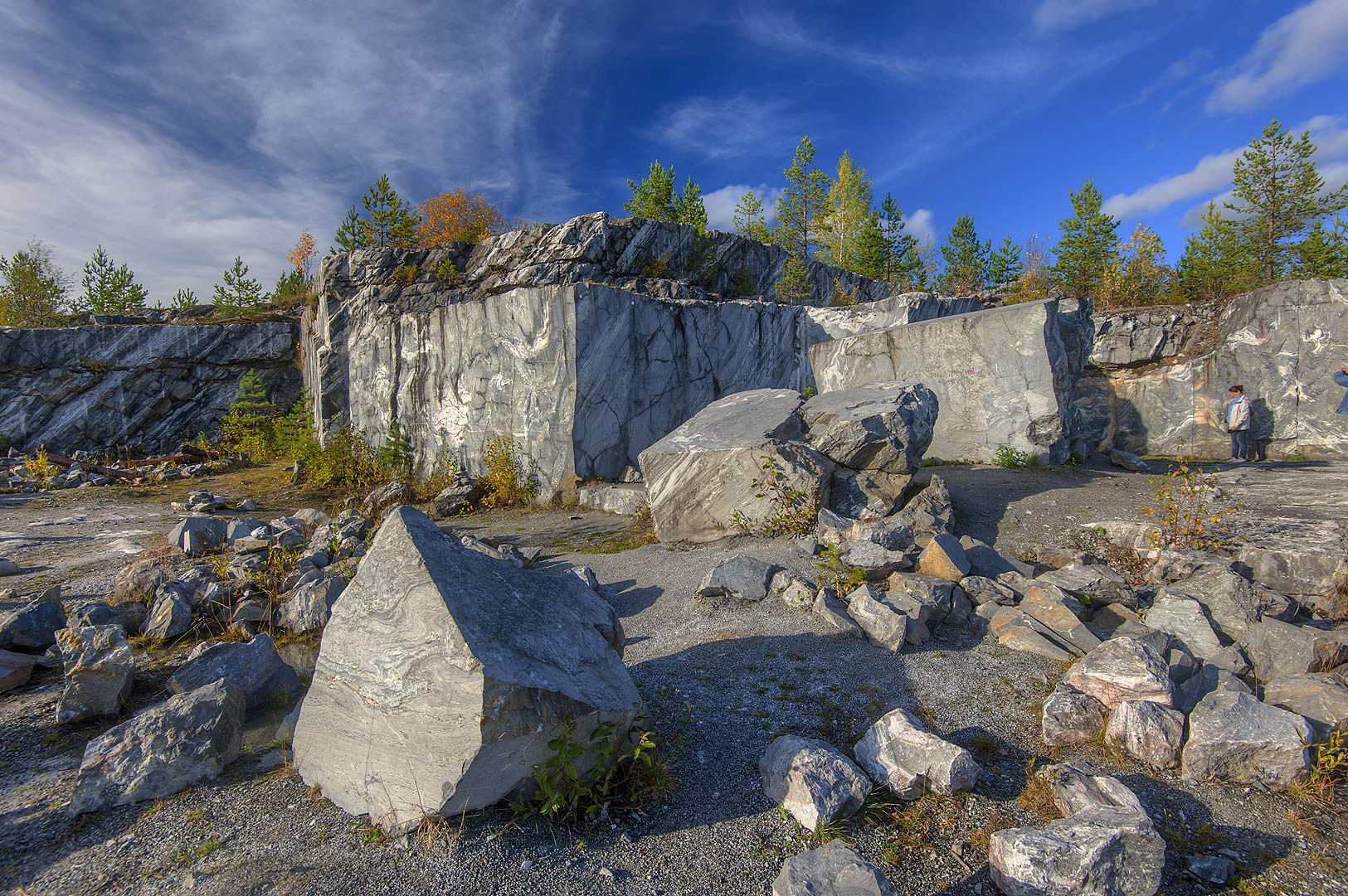 Marble fragments in abandoned marble quarry in Ruskeala Mountain Park. Karelia, Russia
