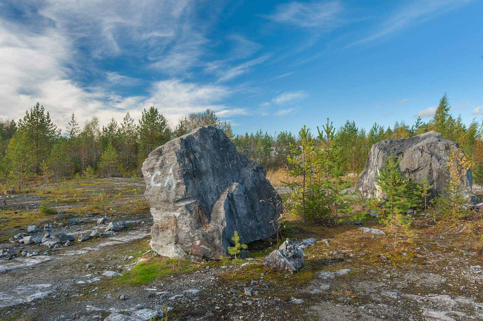 Large rocks near marble quarry in Ruskeala Mountain Park. Karelia, Russia