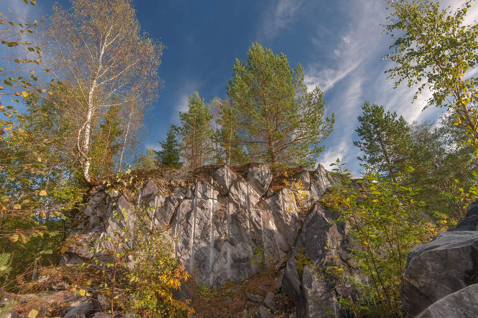 Marble cliffs near a quarry in Ruskeala Mountain Park. Karelia, Russia