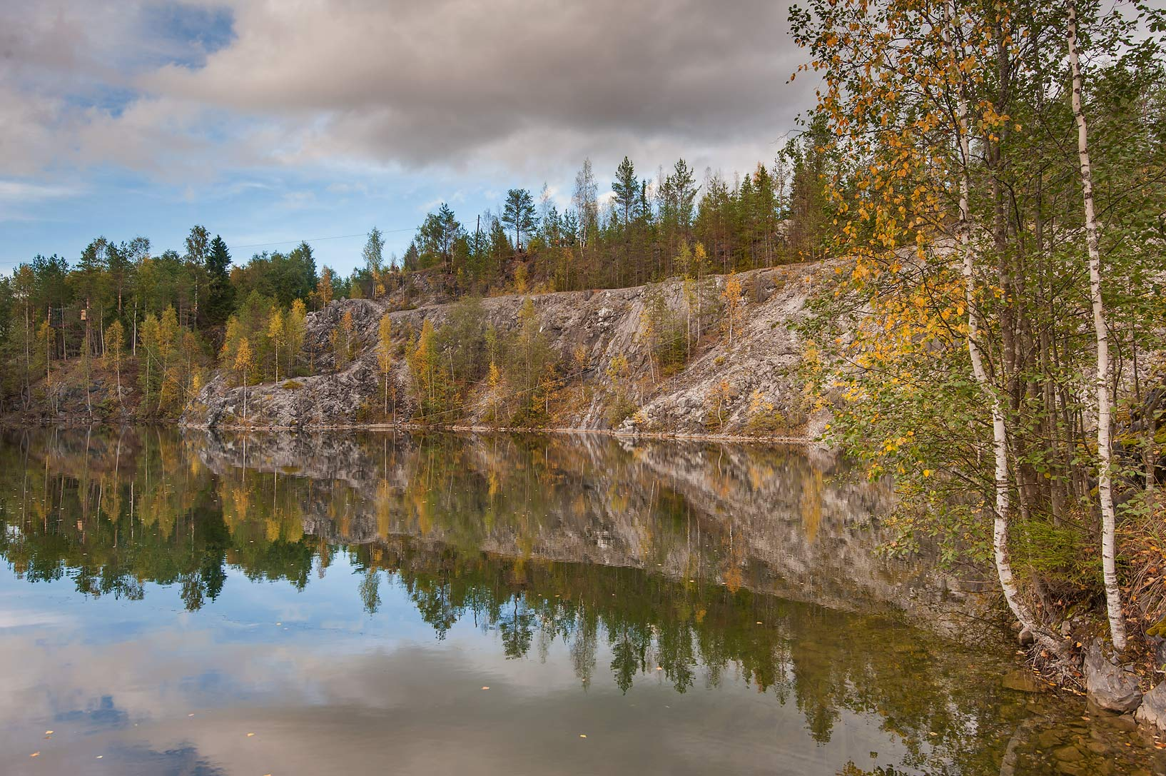 View from southern shore of an inundated quarry in Ruskeala Park. Karelia, Russia