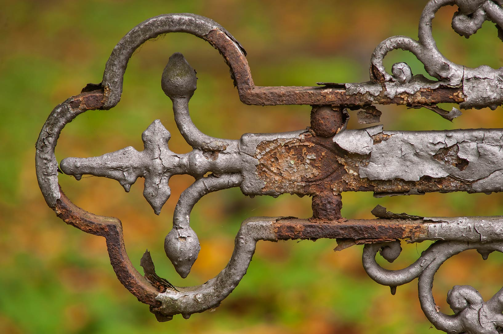 Fragment of a rusty iron cross in Novodevichye...Prospekt. St.Petersburg, Russia