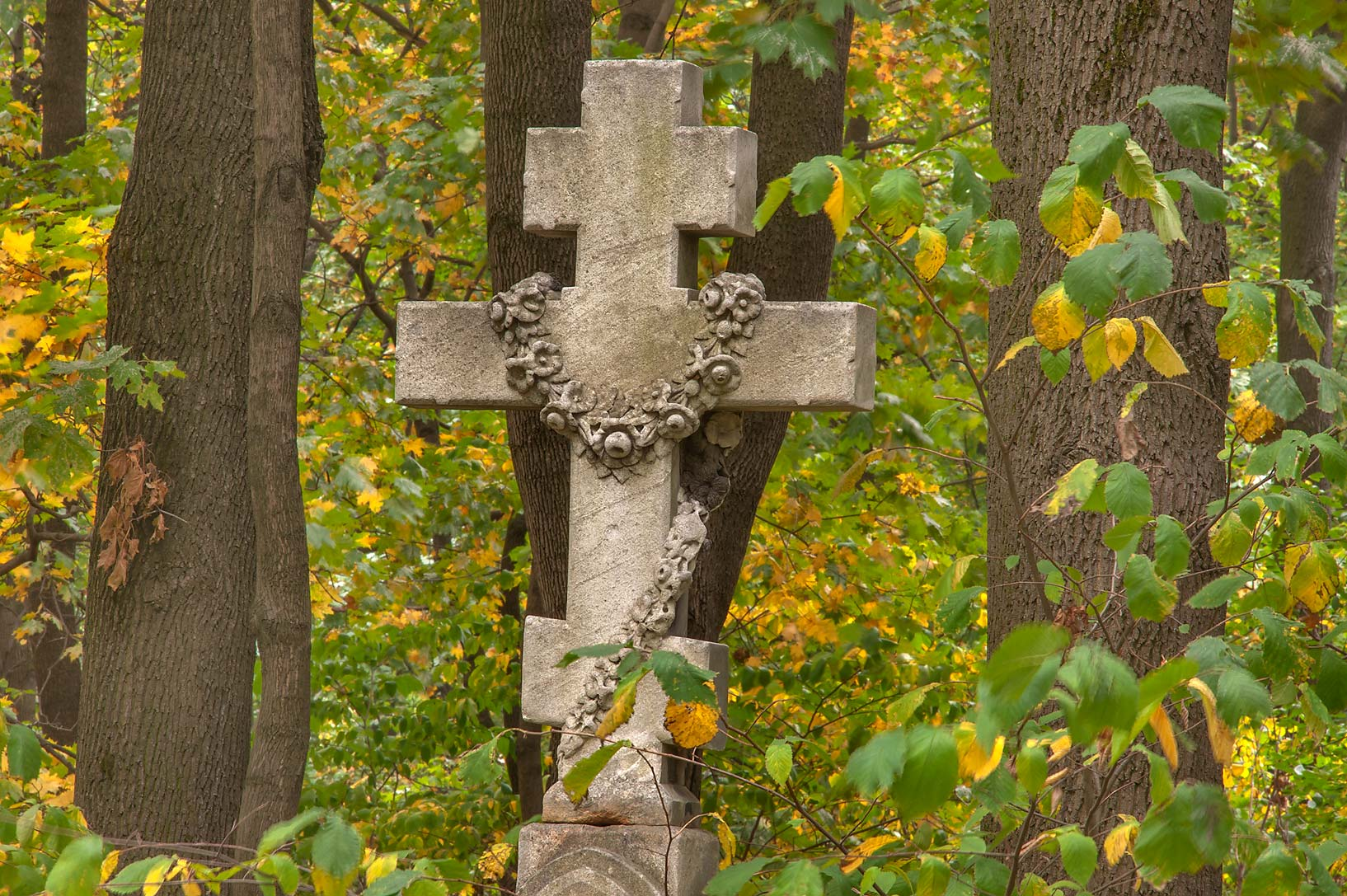 Stone cross in Novodevichye Cemetery at Moskovskiy Prospekt. St.Petersburg, Russia