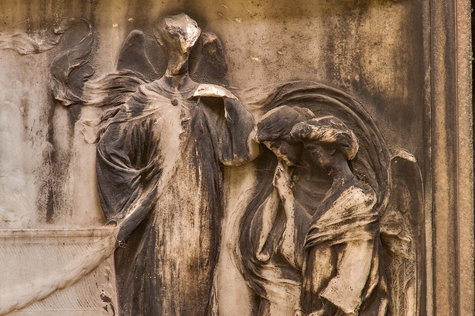 Remains of marble figures in a stone mausoleum in...Prospekt. St.Petersburg, Russia