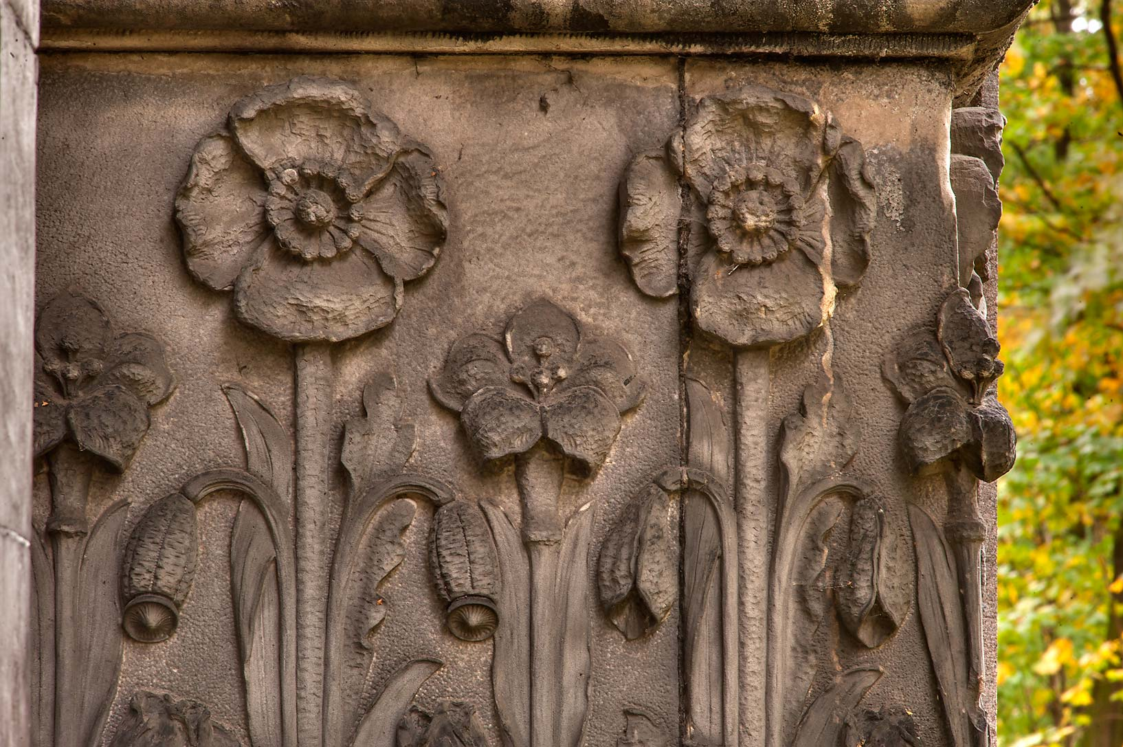 Stone flowers on walls of a mausoleum in...Prospekt. St.Petersburg, Russia