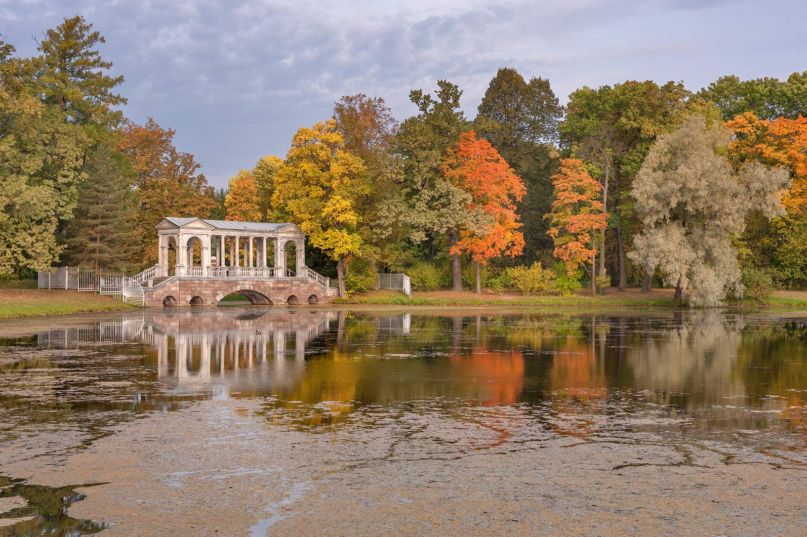 Fall colors around Marble Bridge of Great Pond in...south from St.Petersburg, Russia