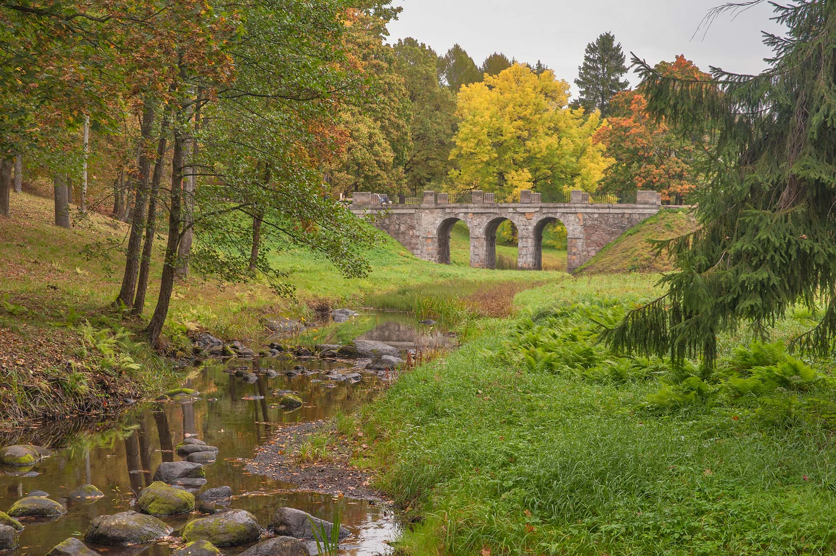 Stone bridge of Karasta River in the park...a suburb of St.Petersburg, Russia