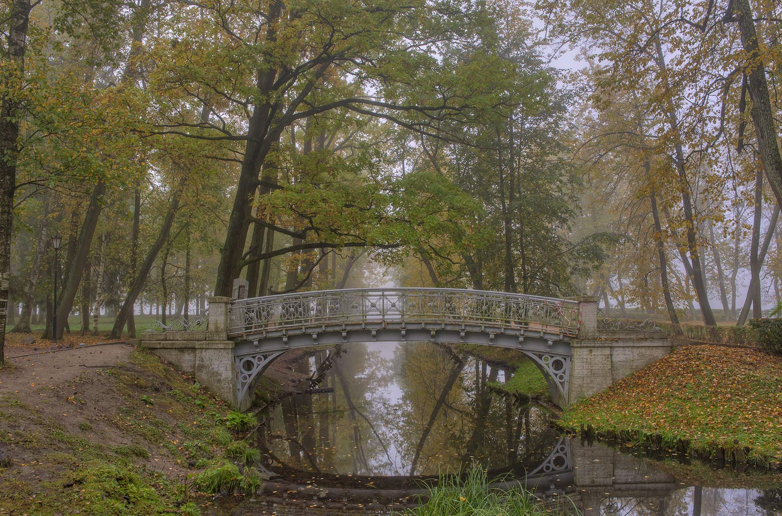 Foot bridge in fog on Love Island in Gatchina, a suburb of St.Petersburg. Russia