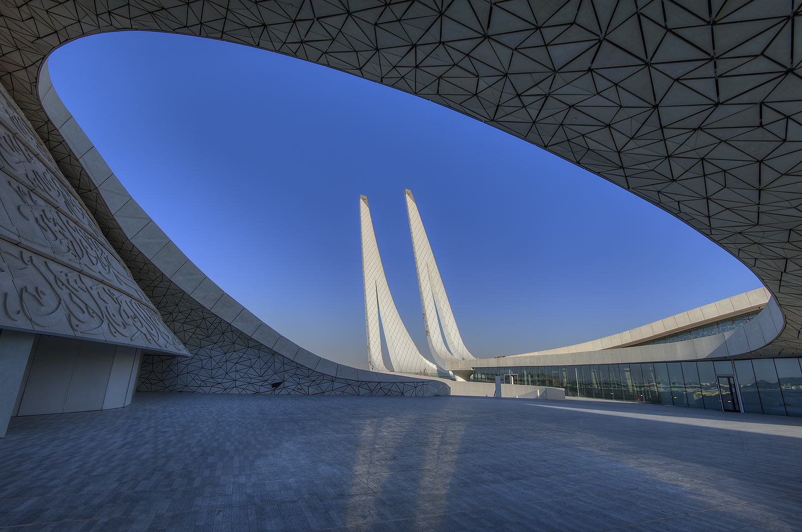 Oval courtyard and concrete pillars in Education City Mosque. Doha, Qatar