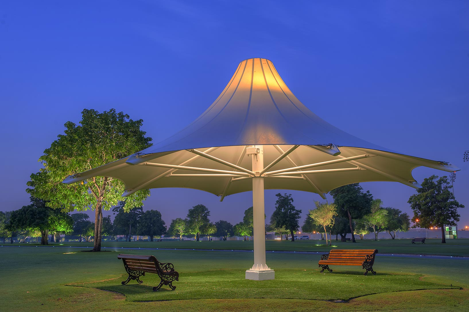 Shade with benches in Aspire Park at morning. Doha, Qatar