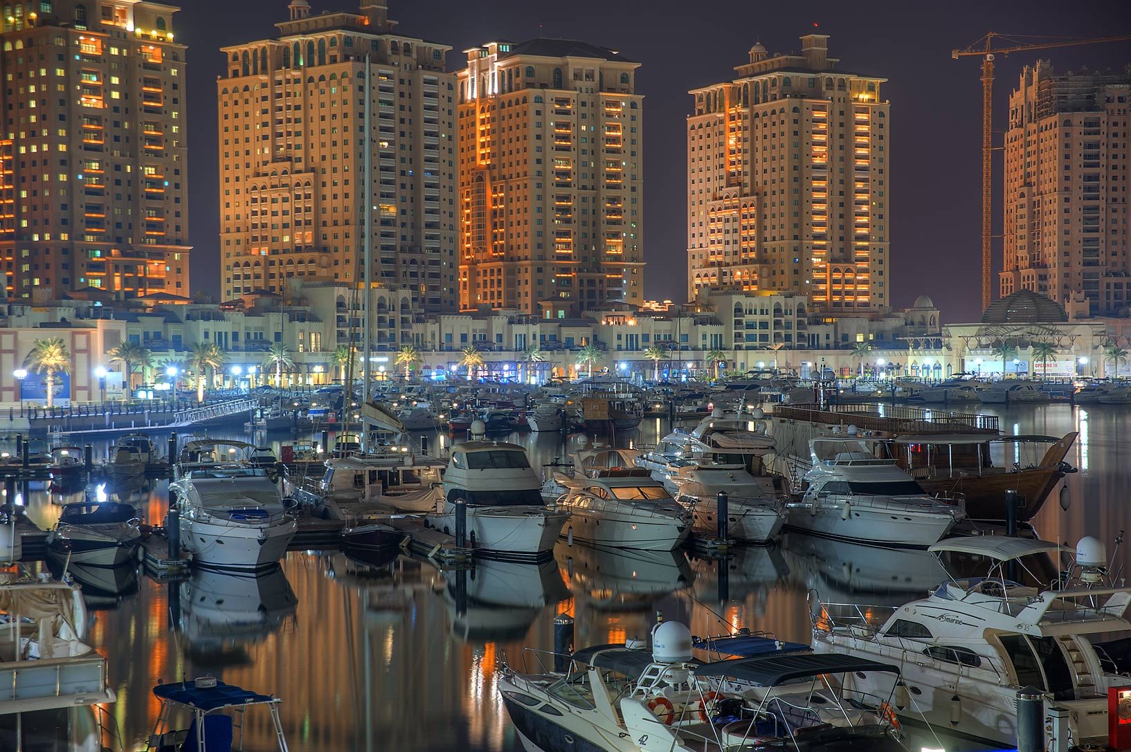 Boats in marina of Porto Arabia in Pearl Qatar Development. Doha, Qatar