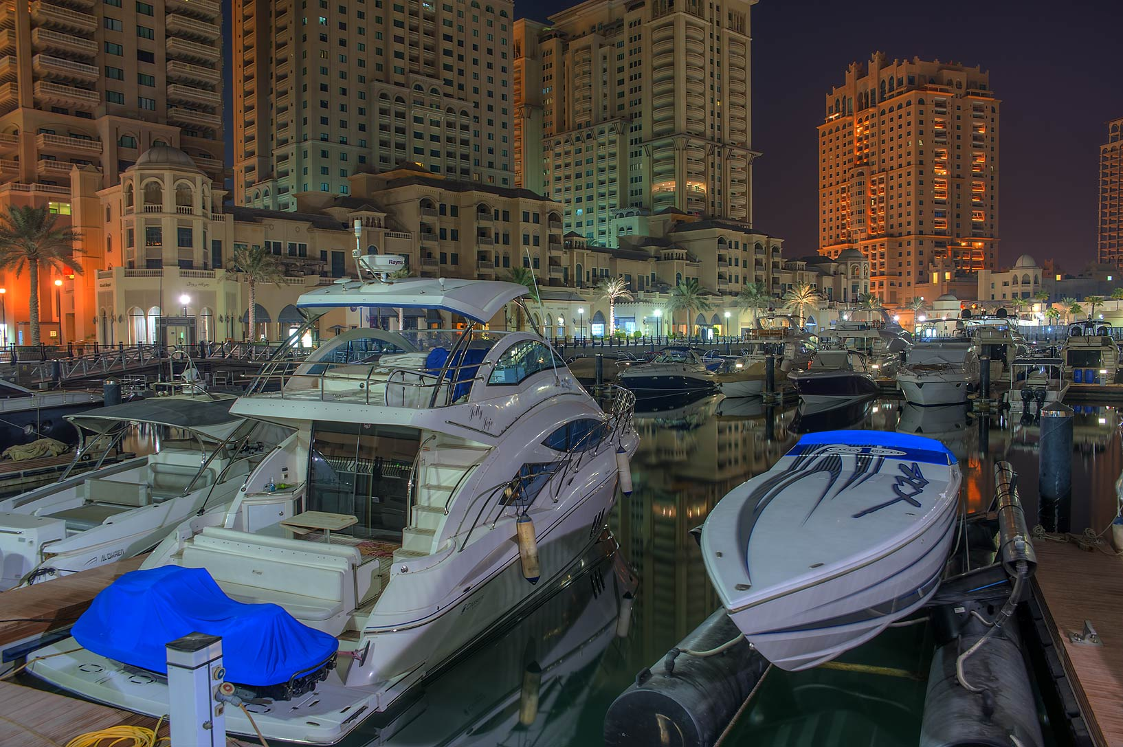 Parked yachts in marina of Porto Arabia in Pearl Qatar Development. Doha, Qatar