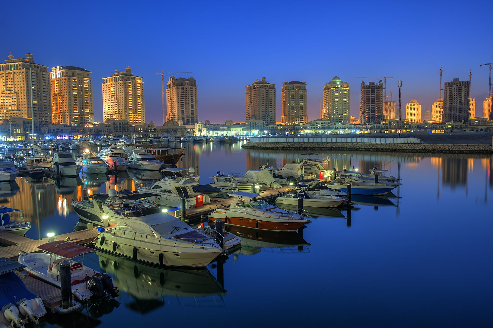 Marina of Porto Arabia in Pearl Qatar Development at dusk. Doha, Qatar