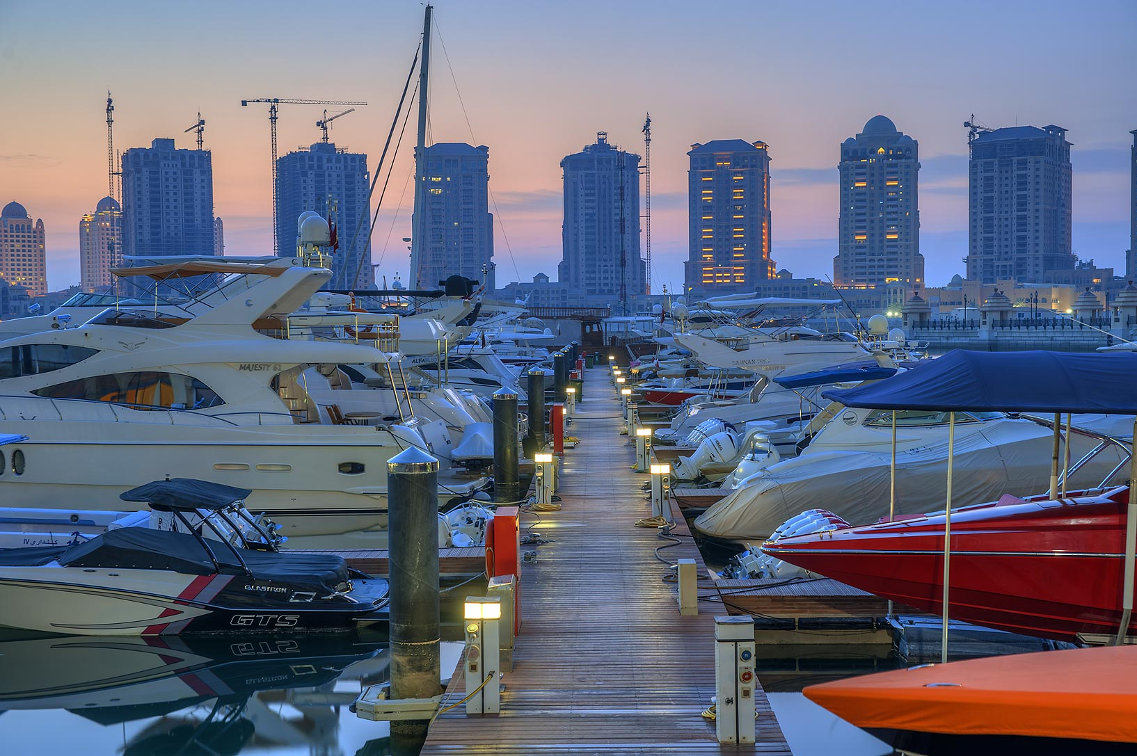 Rows of boats in Porto Arabia in Pearl Qatar Development. Doha, Qatar