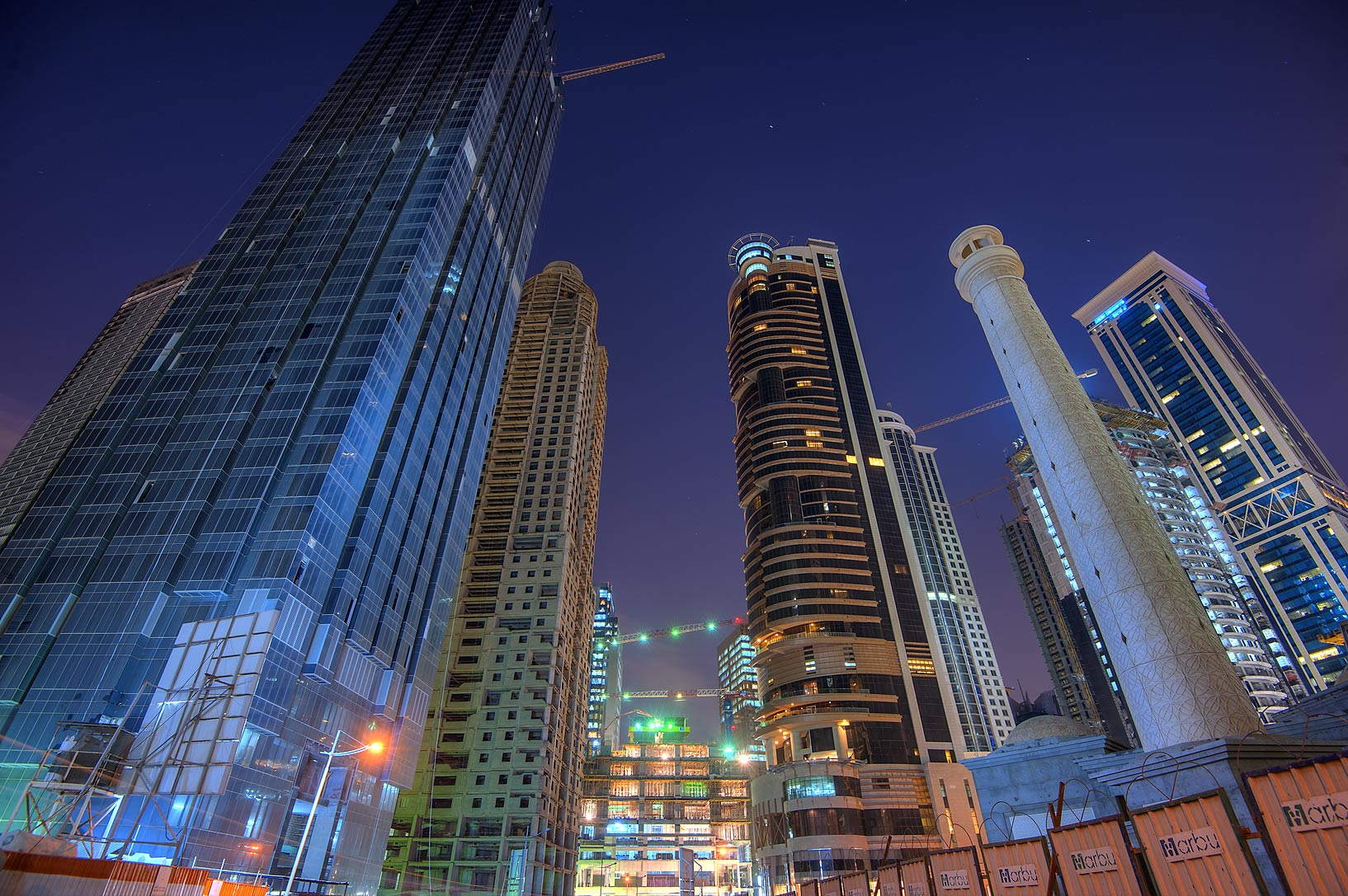 Area of Melia Tower and a lighthouse like mosque in West Bay. Doha, Qatar