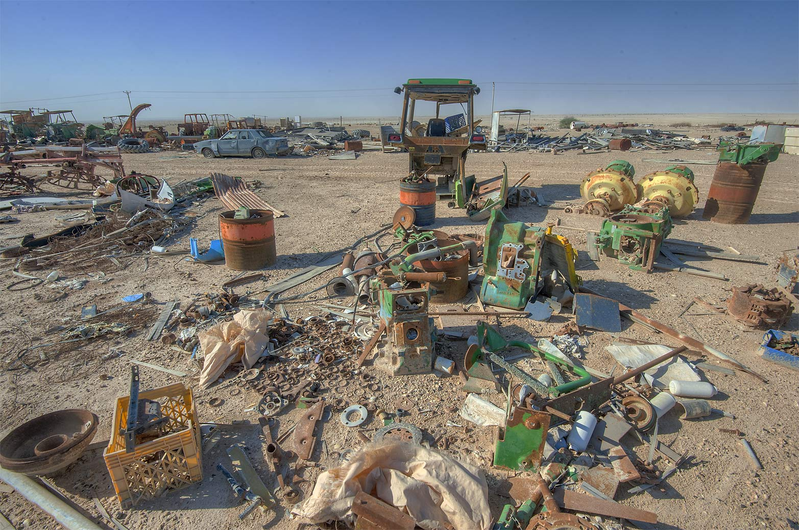 Loose spare parts for agricultural machinery on...in Irkhaya (Irkaya) Farms. Qatar