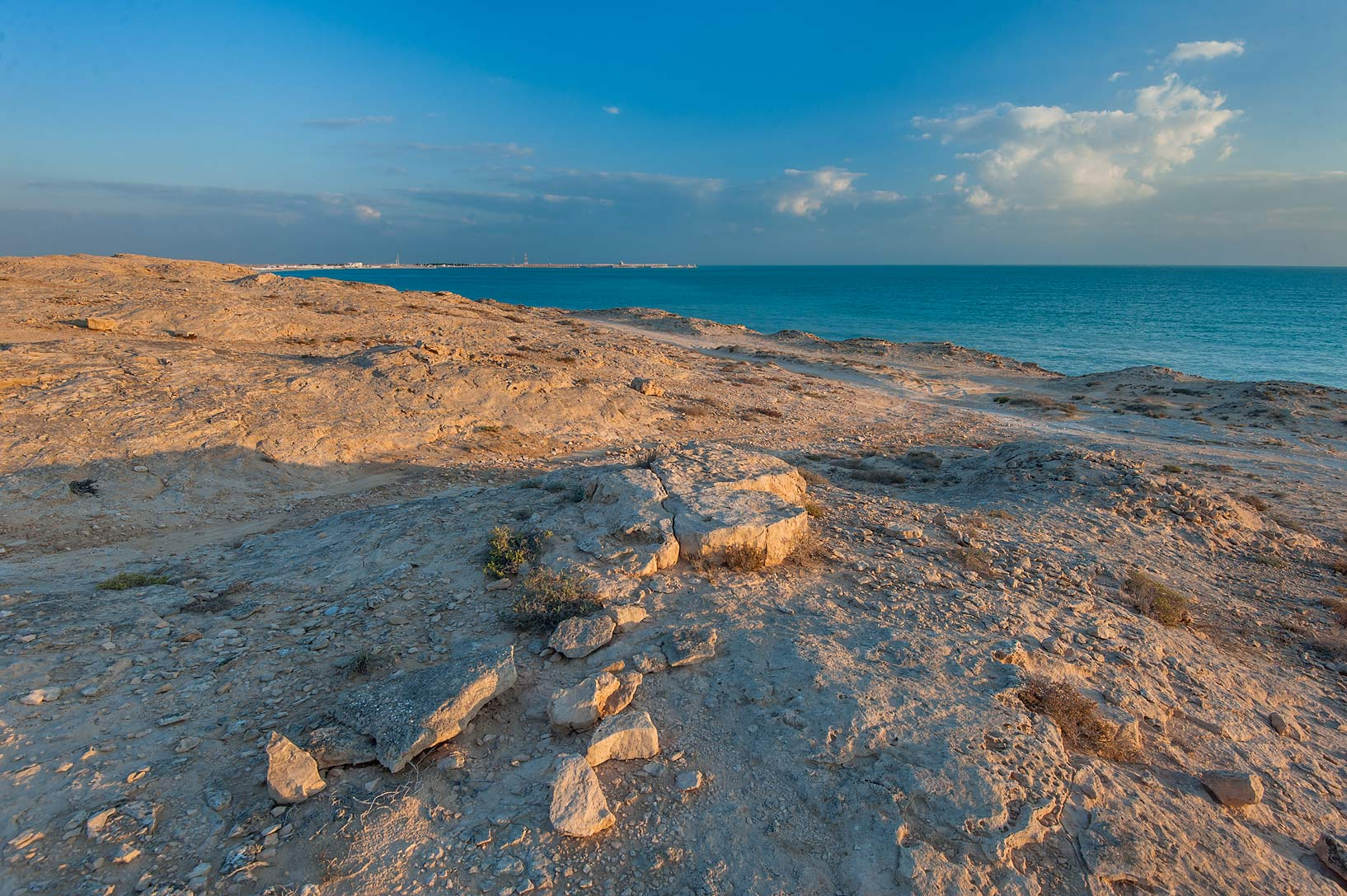View from limestone hill of Jebel Fuwairit at sunrise. North-eastern Qatar