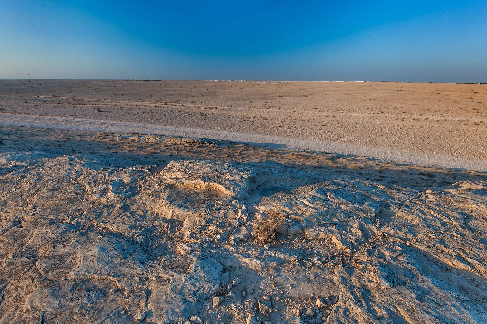 Area of salt marshes (sabkha) from rocky ridge of Jebel Fuwairit. North-eastern Qatar