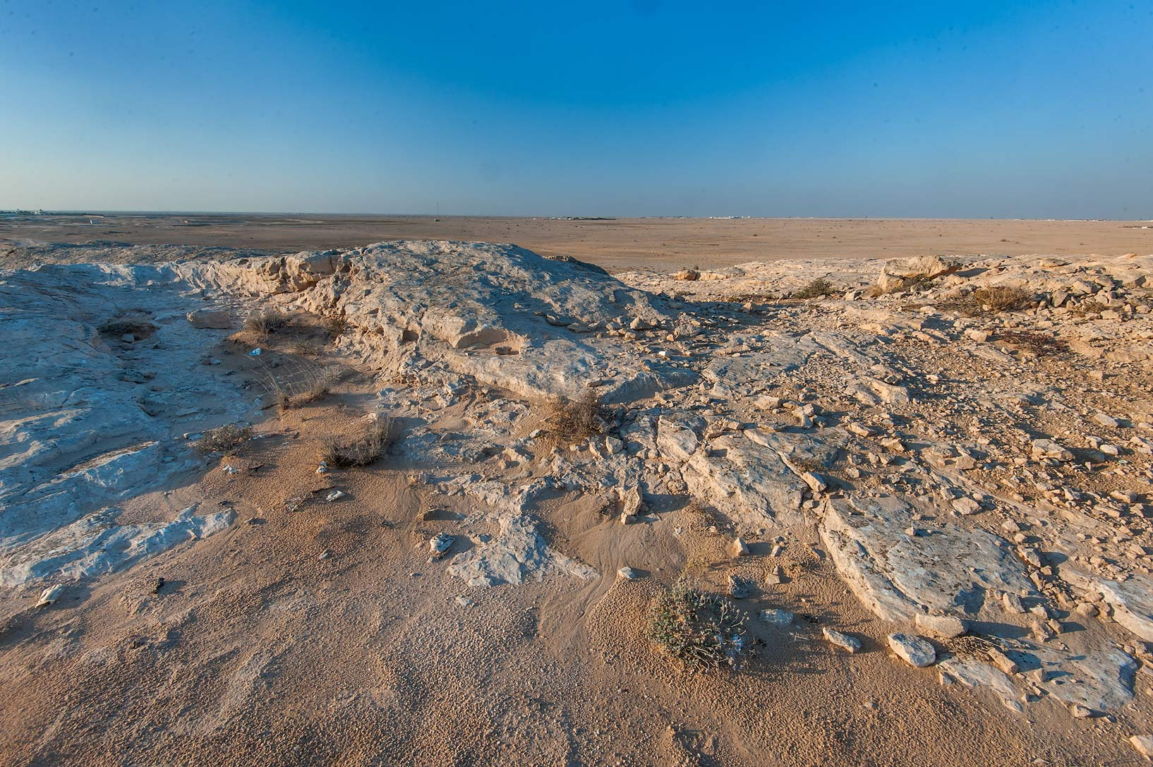 Sandy slope of limestone hill of Jebel Fuwairit at sunrise. North-eastern Qatar