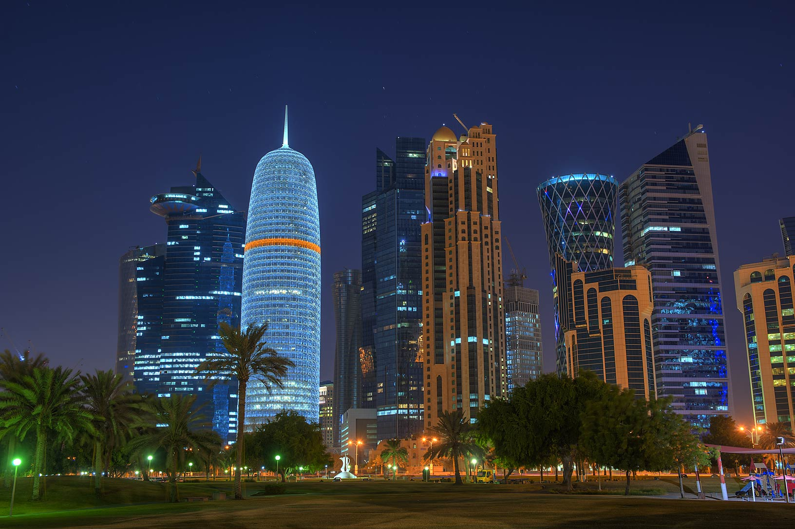 Lights of Burj Qatar Tower in West Bay from Sheraton Park on Corniche. Doha, Qatar
