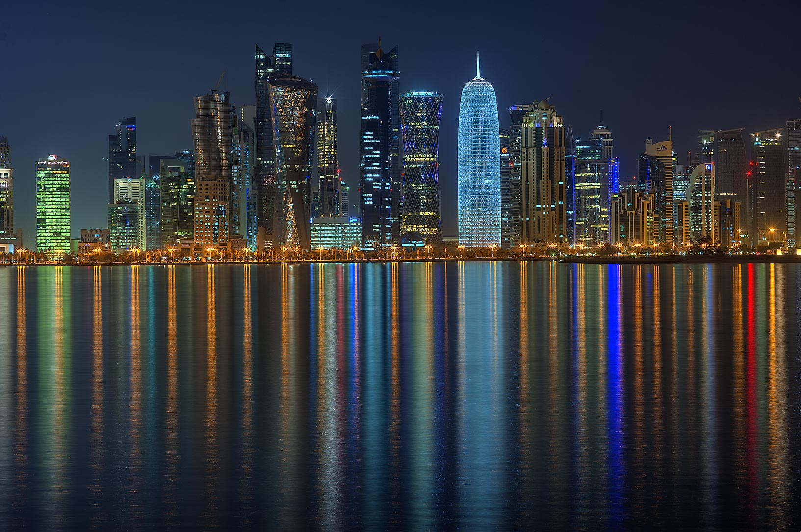 Reflections of West Bay from Corniche promenade. Doha, Qatar