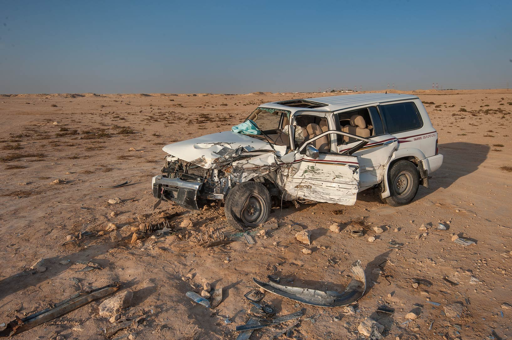 Wrecked car at sunrise in Al Jefair. Al Thakhira, Qatar