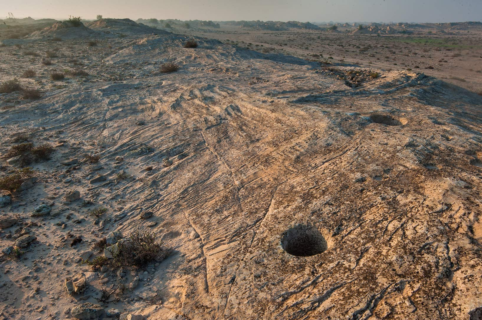Stone pit on rock carvings (stone engravings...site, on north-eastern coast. Qatar